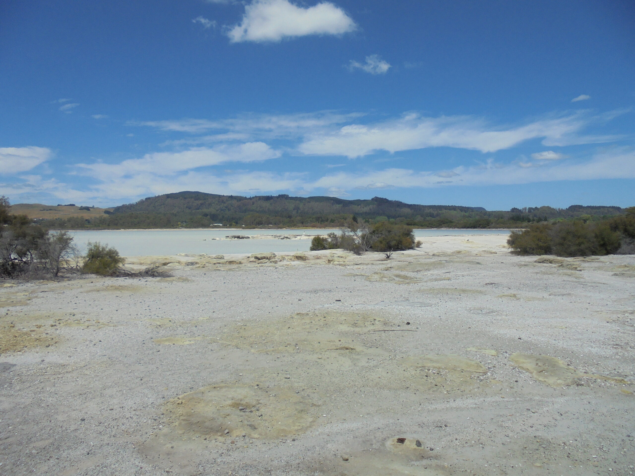 The view from Sulphur Point in Rotorua, overlooking Lake Rotorua. The yellow colour in the foreground is deposits of elemental sulphur, produced by the local volcanic activity near this town.